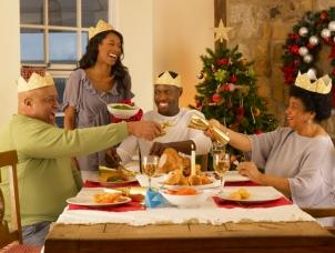 Adult African American family having Christmas dinner